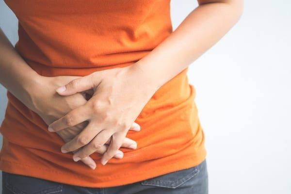 Bloating and pelvic discomfort can be signs and symptoms of ovarian cancer (Photo: Shutterstock)