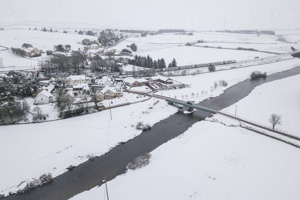 Drivers warned of hazardous conditions as snow and ice affect parts of UK